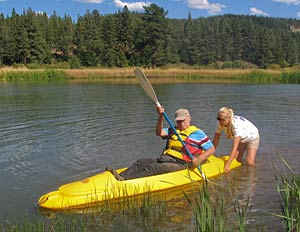 Thurston gets help into the kayak